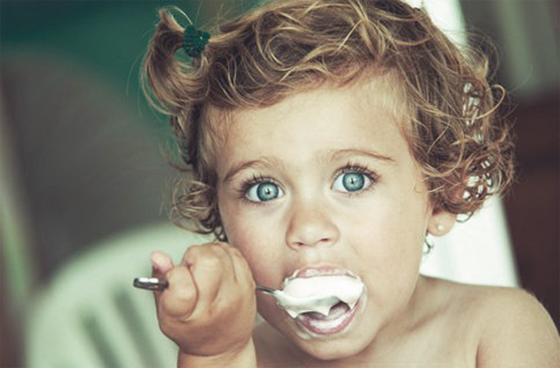 A child eating icecream.